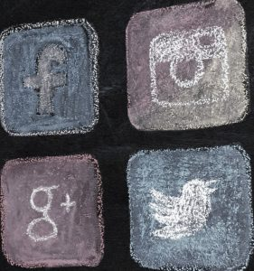Social Logos On Chalkboard